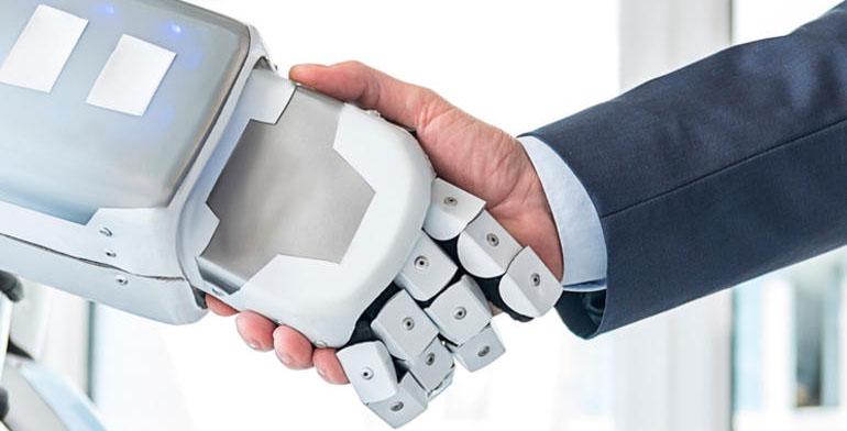 Робот здоровается за руку с человеком
